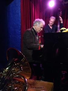David Amram at Cornelia Street Cafe, January 4, 2015; bassist Rene Hart behind him. Photo © 2015 Ira Mayer.